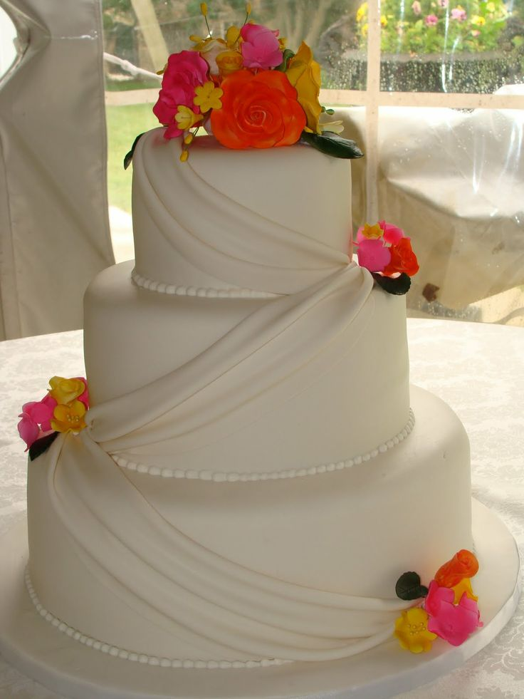 hot wedding cakes pink and yellow wedding cake summer wedding 15343