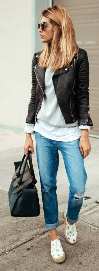 Cristina Monti + keeps it cool and casual + pair of distressed boyfriend jeans + classic style + white tee + sweater + leather biker jacket + pair of patterned shoes   Jacket: Zara, Jeans: J Brand.