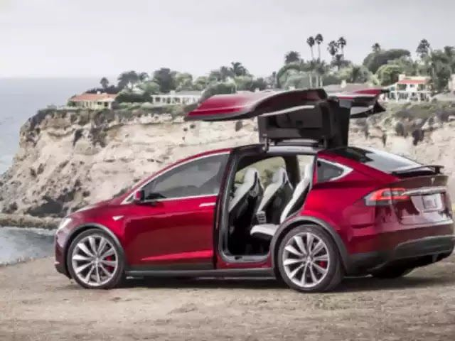 SAN FRANCISCO — Tesla Motors CEO Elon Musk bestowed a New Year's gift on 1,000 customers by activating a suite of new Autopilot feature...