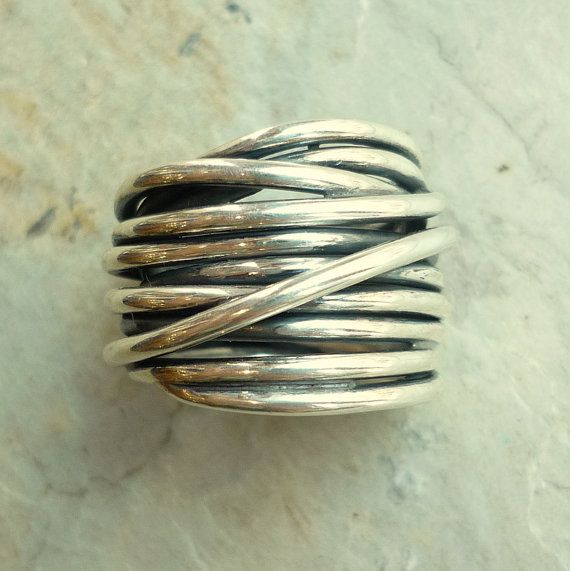 This is a beautiful chunky ring made from sterling silver wire. It twists around the finger creating a rich modern style. (k #399)  Dimensions: Size 7