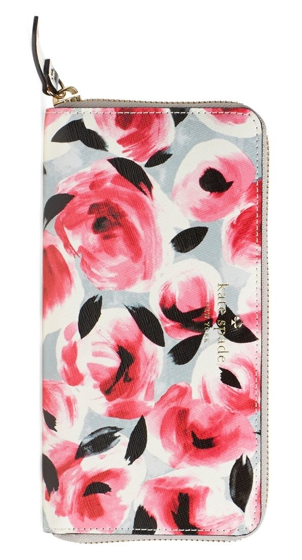 Swooning over this vintage inspired, floral print wallet by Kate Spade that is perfect for storing cards and cash.