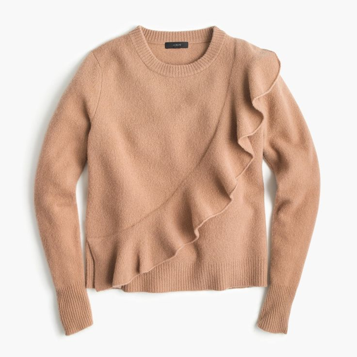 This super cute sweater is also super cozy, thanks to warm and fuzzy boiled wool. Semifitted. Hits slightly below hip. Length: 22 1/2. Merino wool. Hand wash. Import.