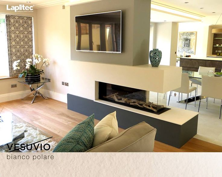 A modern fireplace always makes a home look warmer. The fireplace becomes the center of attention with Lapitec® Vesuvio in this home in the United Kingdom.