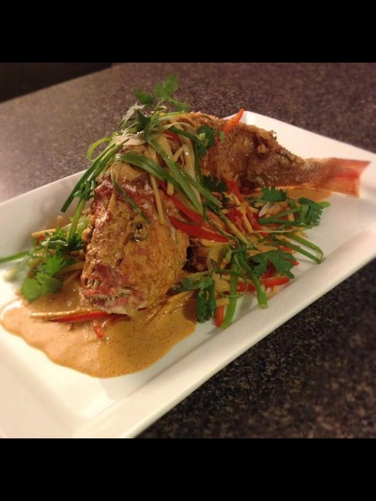 Tempura whole red snapper, chillies, bamboo shoots, green onions, cilantro, red Thai curry sauce. #chef_junpet