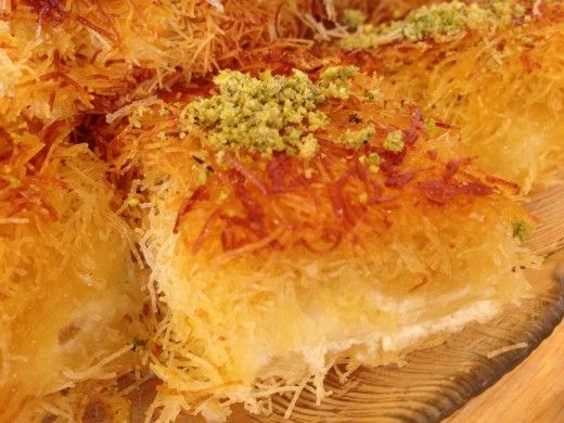 Kenafeh also spelled knafeh, kunafeh, or kunafah, is an Arab cheese pastry soaked in sweet syrup. Very popular in the Middle East especially Syria, Lebanon, Palestine, & Turkey