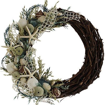 Don't forget the beach house when decorating for the holidays. This natural grass and shell wreath is the perfect door décor. | $111