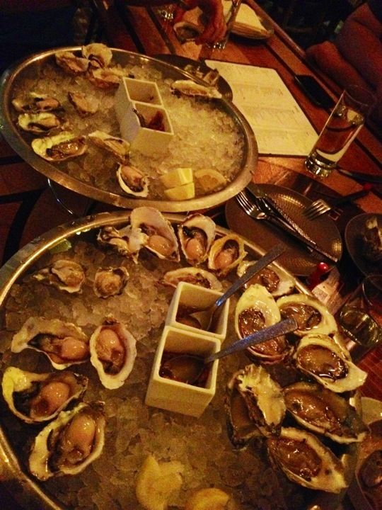 "GT Fish and Oyster ""Tradition and novelty come together on the small-plates menu and in the sleek dining room. Drop anchor for clam chowder and lobster rolls, but also for a one-bite oyster po' boy slider fired up with kimchi, and an elegant Thai-style seafood soup. The nautical design finds a wall of fish jaws, teakwood floors and a boomerang table in the bar."" -Tom Sietsema, ""The search for America's best food cities: Chicago,"" Washington Post"