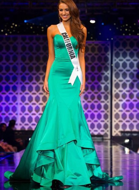 Could Miss California Teen USA 2015, Melanie Mitchell, be any more lovely and statuesque?! The minimalistic trend was alive and well at this year's national pageant and this structural gown ensures all eyes were on Melanie.  The Color -   Arguably the color of the year, this emerald green looks gorgeous against her California girl tan and her chestnut brown hair