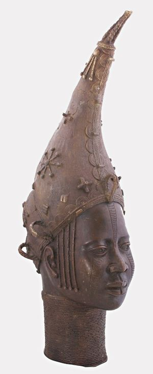 Queen mother. Circa. 1880, this Edo Queen Mother Bronze is a casting in honor of the Oba's (King's) mother, who had the same authority as that of senior town chiefs.  The right to wear a coral-bead crown is limited to the Oba, the queen mother, and the Ezomo, the Oba's principal war chief, and thus conveys the queen mother's importance in the Benin political hierarchy.