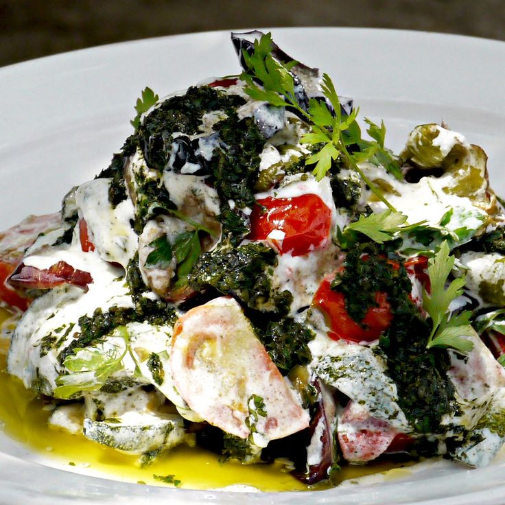 Vegetarian Turkish style vegetables with yoghurt and green chilli oil. Yotam Ottolenghi
