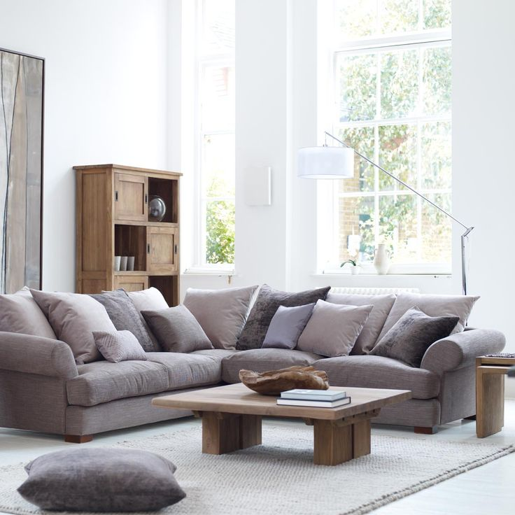Sofas like this but in linwood 'flint', with block square arms and fewer cushions. Sofa bed included.