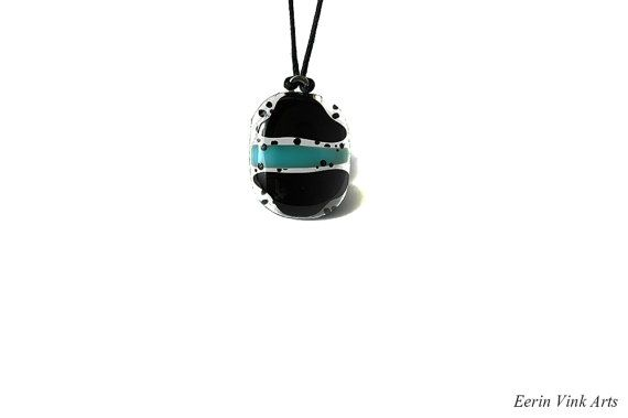 Black and turquoise pendant with poke dots. This artist also makes fantasy paintings and illustrations. You can find her work on this website: eerinvink.etsy.com