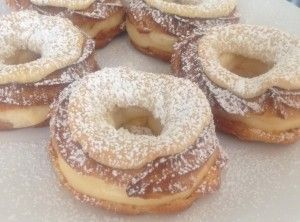 A traditional Almond Paris Brest recipe. This beautifully elegant pastry treat is a French delicacy that is a mix between a Profiterole and an Éclair with an almond twist. Elegant, tasty, rich and creamy this treat is satisfaction!