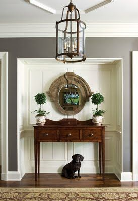 Lovely entry- The grey walls give a great contrast to the white niche & show up the lovely sideboard so well. Love the light fitting