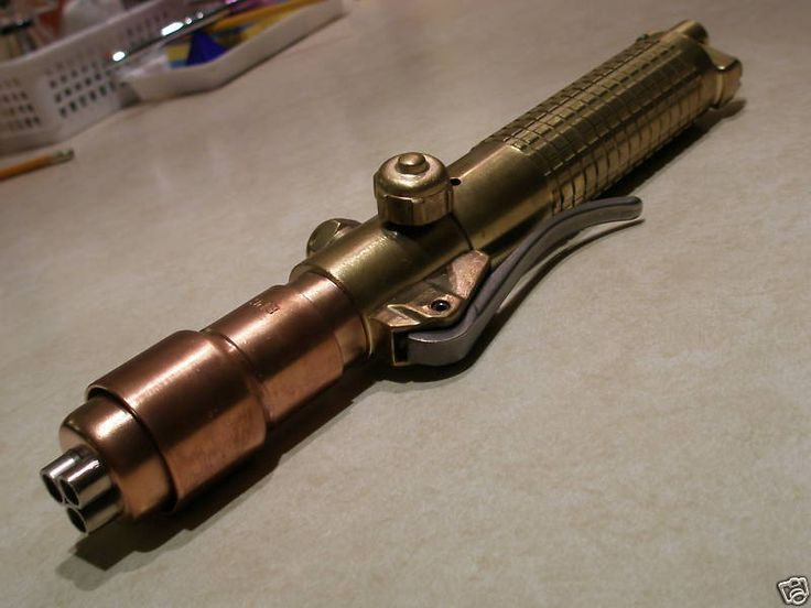 """""""Steampunk Lightsaber""""  I've had this idea walking thru the shops at work. Part of that handle is a cutting torch."""