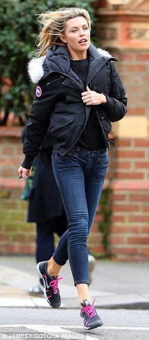 Quick on her feet: Abbey Clancy races back to her car on Thursday after realizing she's ab...