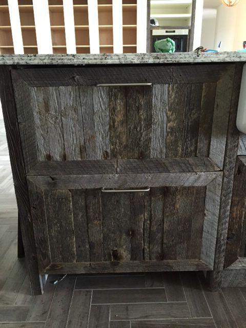 Barn wood faced refrigerator drawers.