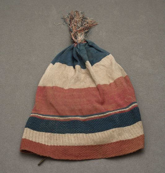 Liberty cap, France, 1789-1795. Silk knit in blue, cream and red; worn during French Revolution.