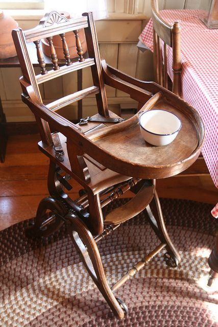 Amazing antique high-chair with an opening for potty and the adjustable feet/height by L. Z., via Flickr