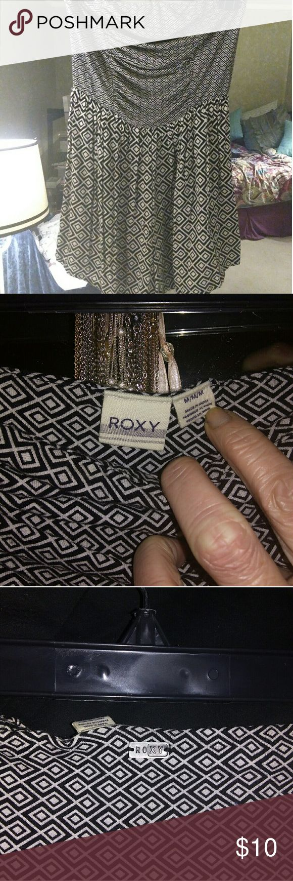Roxy strapless Romper, sz Medium Roxy black and cream patterned romper. Junior's size medium. It is designed to look like a dress when worn. Super cute. Great condition. Roxy Other