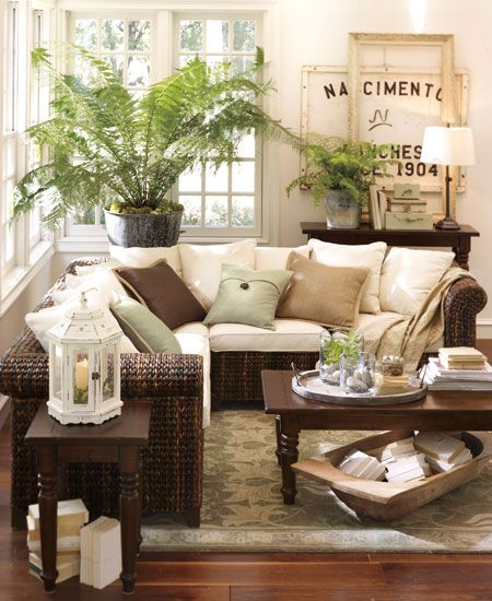 Sun room full of books plants perfect furnishings for for Pottery barn style living room ideas