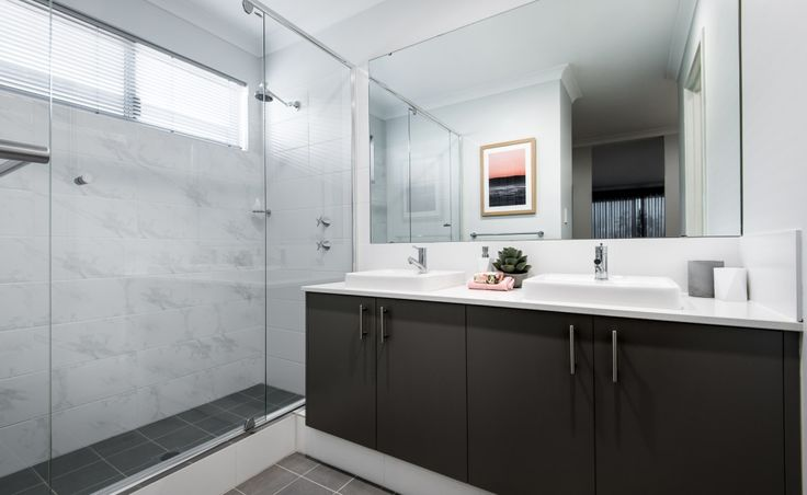 The stylish ensuite features twin vanity basins, double shower and separate WC