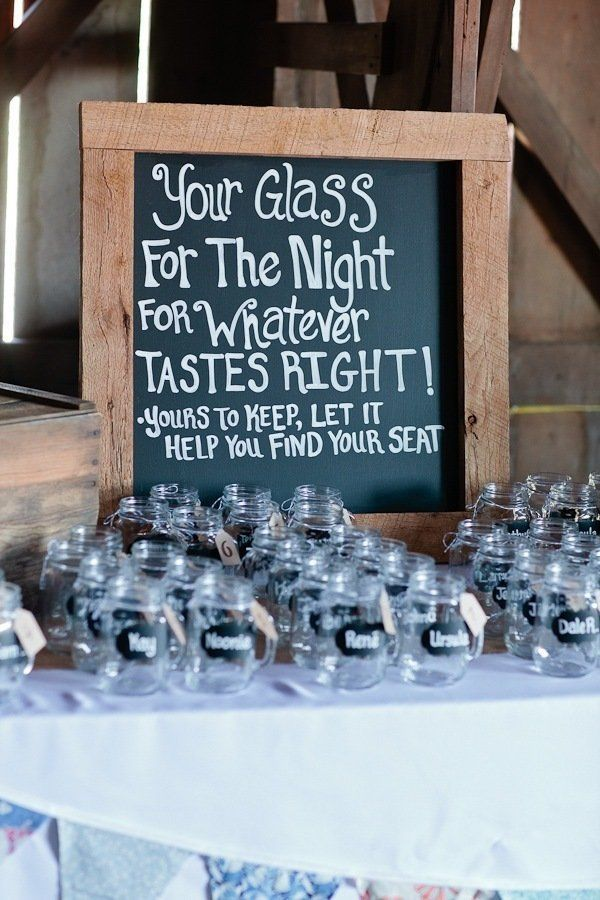 personalized glasses with the seating plan for the wedding reception as part of the set-up on the glass, so cute!