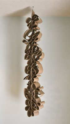 I think this would be a great lesson for the end of the year.  Put the kids into groups and have them use paper scraps to create a hanging sculpture!