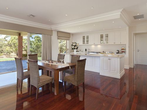 White kitchen  with gyprock #ceilings and art deco style #cornices.. Open plan living with dining area and highly polished timber floors all up stunning #kitchen #white #diningrooms