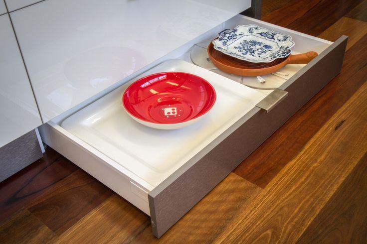 Kickboard drawer. Platter storage. www.thekitchendesigncentre.com.au