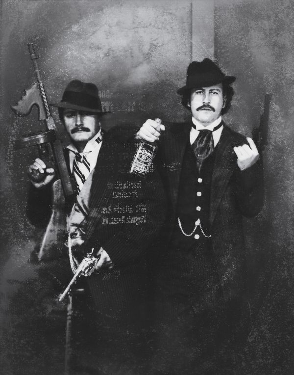 Pablo Escobar and his cousin, Gustavo Gaviria, dressed as gangsters, while visiting the Museum of the FBI (which no longer allows tours) in Washington D.C. (1980s).