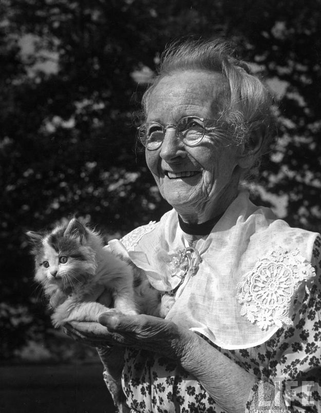 22.  Grandma Moses holding a kitten, 1947 | 40 Sweet Cat Photos Of The '40s
