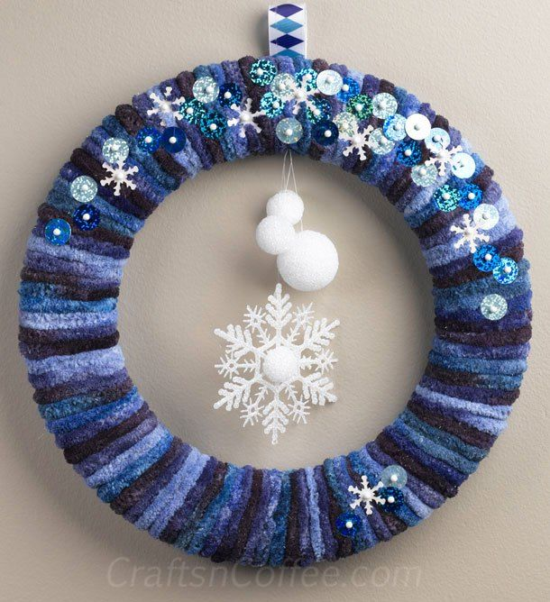 how to make an easy winter yarn wreath with snowflakes and snowballs