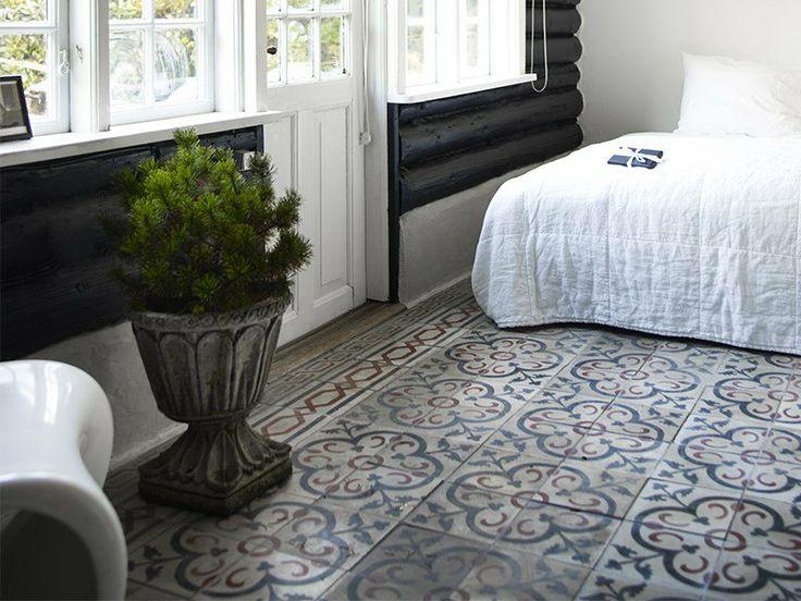 Moroccan tiles and bedroom of norwegian cabin