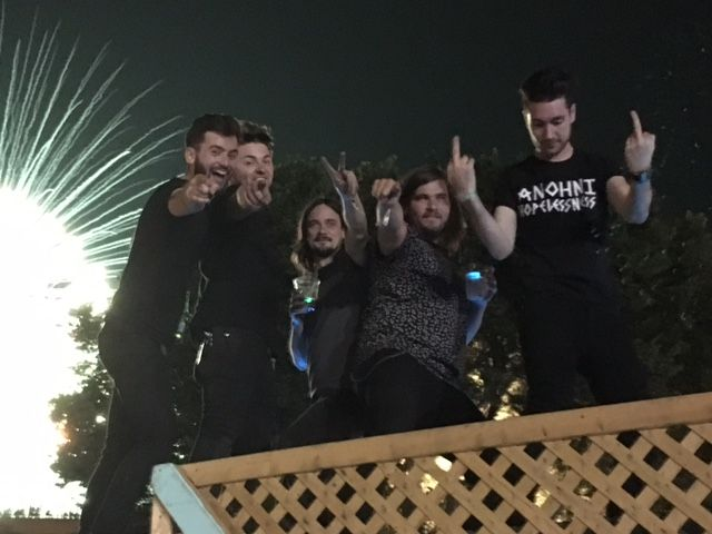 Another angle of us and the fireworks. Charlie on the left, who plays guitar with us, and two of our crew members. Then Woody and me on the end. Definitely a sober group of people.
