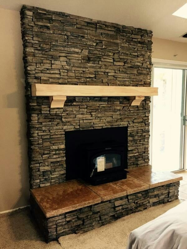 El Dorado Nantucket Stacked Stone Travertine hearth with Rustic mantle