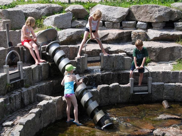 The water playground, Furtwangen, Germany. I love this multi-level water playground, designed by Richter-Spielgeraete. You pump up the water by hand with that big Archimedes' screw, and it flows through stone channels with lock gates. Pinned by Alec of http://childsplaymusic.com.au/