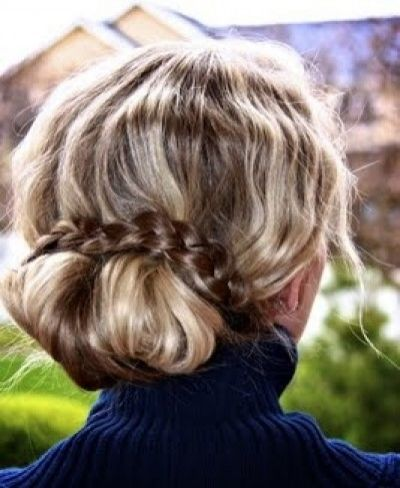 Cute messy bun hairstyle with a gorgeous braid