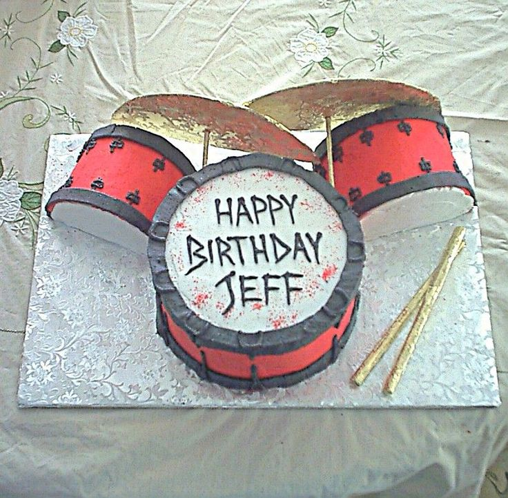 Happy Birthday drum set - Main drum - 2 layer chocolate cake; side drums are french vanilla.  All buttercream icing; cymbals & drumsticks are foiled covered board & lollipop sticks.