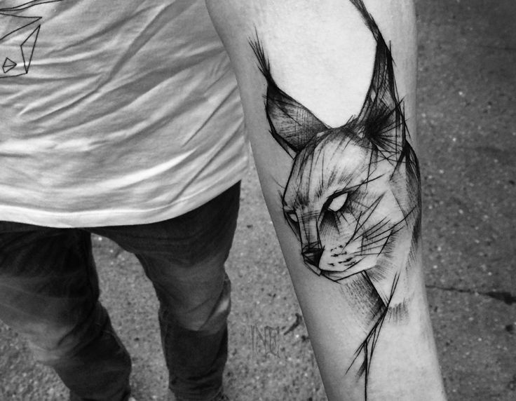 feather tattoo on thigh