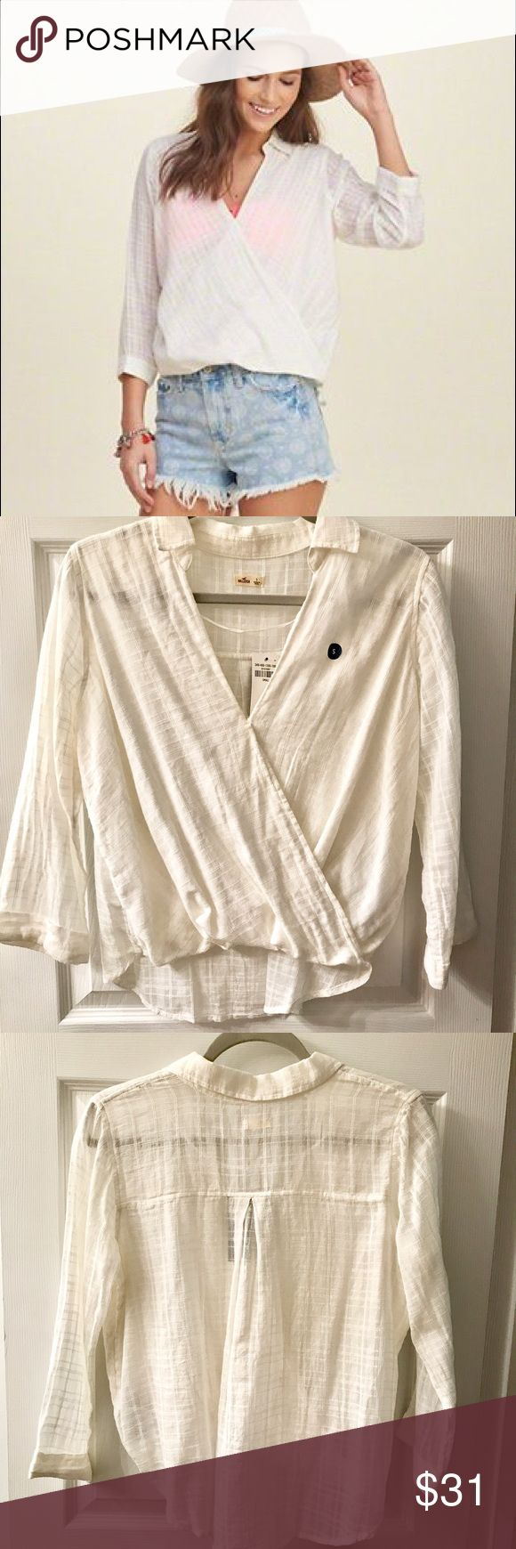 NWT Hollister White Wrap Front Shirt Super cute NEVER WORN wrap front shirt from Hollister! I really don't know why I never wore it - perfect for summer or ever to cover up a bathing suit! NWT - kind of see through and it's between true white and off white. Hollister Tops Blouses