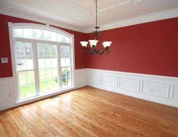 red dining room | Impressive red dining room with off-white wainscoting