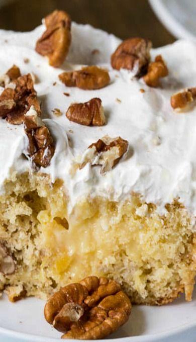 Hummingbird Poke Cake. Boxed yellow cake mix, banana, pineapple, cinnamon, pecans, vanilla pudding mix, cream cheese, sweetened condensed milk, whipped cream, powdered sugar