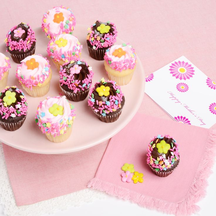 Mother's Day Mini Cupcake Bouquet!  A delicious set of cupcakes just for Mom!! This gourmet selection of Chocolate and Strawberry Cupcakes with little candy flowers will be the best bouquet she's every eaten!