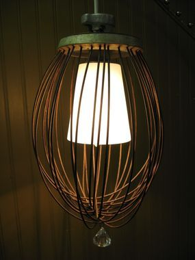 Whisk up a little ambiance! By taking an inexpensive pre-wired pendant lamp and mixing it with a vintage industrial whisk we have all the makings a great junk production needs! FYI, thats Hollywood speak for...Stand back for the special effects!