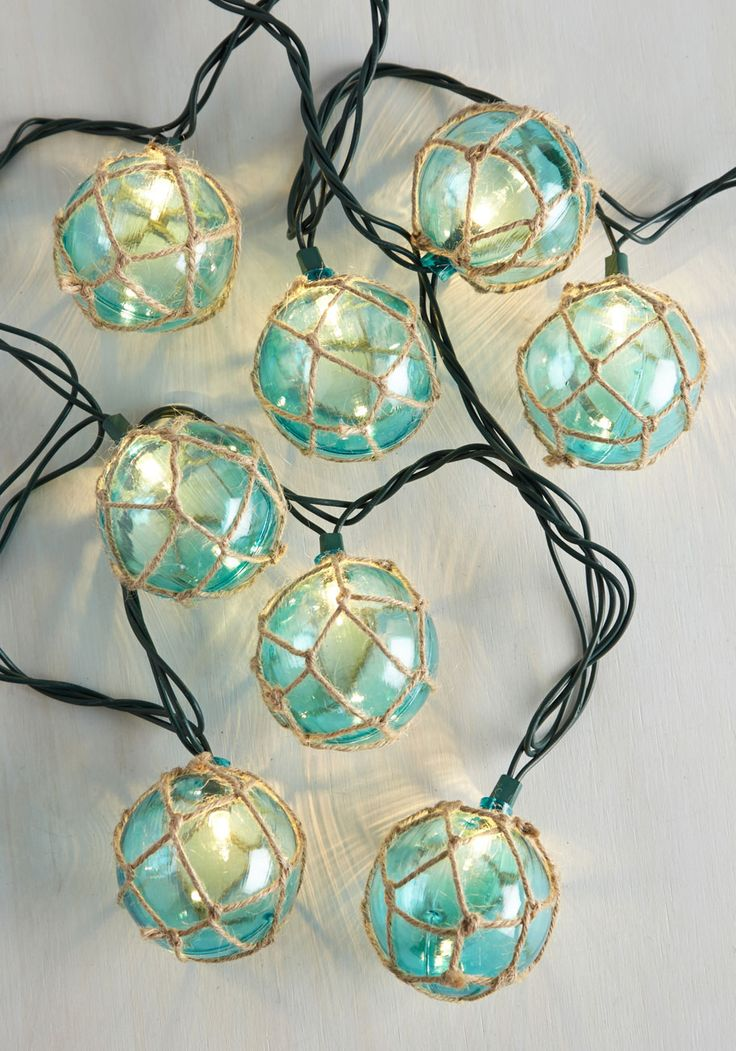 Float the Idea String Lights. So, what do you say about a backyard party? #blue #modcloth
