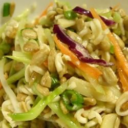 Ramen noodle salad: Combine 1 pound broccoli slaw, 2 packages broken ramen noodles and handful of sliced green onions. Whisk together 1/2C white sugar, 1/4C oil, 1/3C cider vinegar and the chicken ramen seasoning packets. Pour dressing over salad and toss to evenly coat. Serve with unsalted, crushed peanuts and sunflower seeds (approximately 1C each) I would add chicken