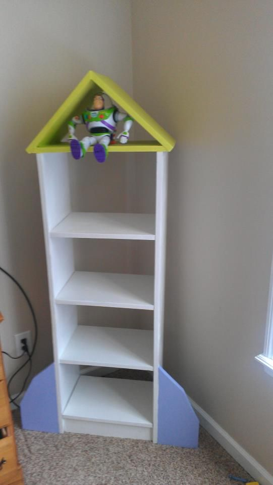 Take plain white bookshelf, add a few embellishments and you end up with a rocket!