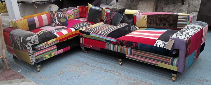 Lot 2 - Estimated £1000 - £1500 - CORNER SOFA, by Squint in multicoloured patchwork fabric, cost £6200 new.