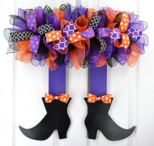 This handmade wreath looks like a witch's skirt, legs, and feet, and would be perfect for Halloween! It can hang on the inside or outside of a door.